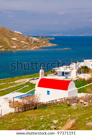 The white and red church of the family background of the sea. Typical for Greece. - stock photo