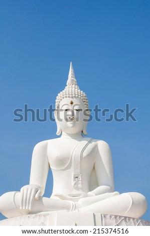 The White buddha status on blue sky background - stock photo