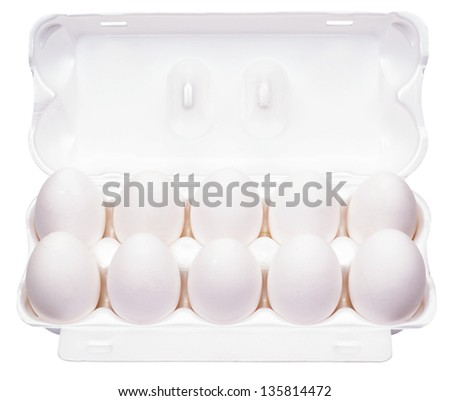 The white eggs in a box isolated on a white background - stock photo