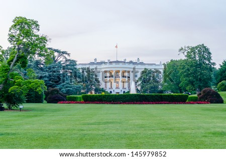 The White House in Washington DC against a cloudy sky - stock photo