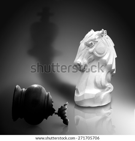 The white knight strong checkers who brought victory to defeat the enemies, Isolated on dark gray background with clipping path. Concept of Strategic Planning to the success of management or business. - stock photo