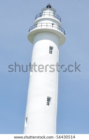 the white lighthouse on blue sky - stock photo
