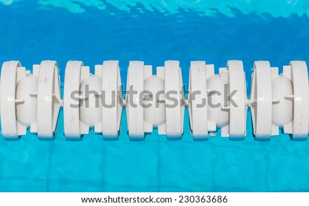 The white marked lanes is floating in swimming pool for competitions preparing.  - stock photo
