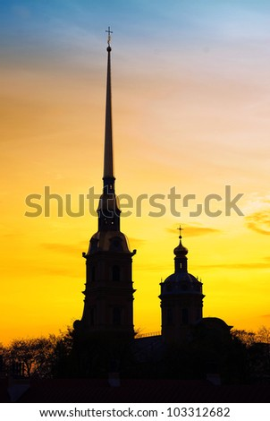 The White Nights of Saint Petersburg, Russia. The silhouette of Peter-and-Paul's Cathedral, located inside the Peter and Paul Fortress - stock photo