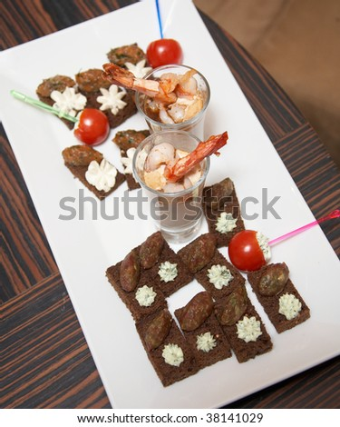 The white plate with different light snacks