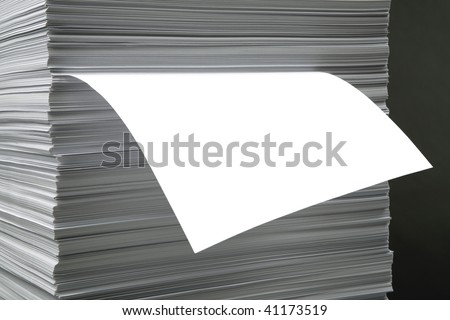 The white pure leaf which is sticking out of a pile of a paper - stock photo