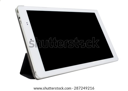 The white tablet in standing tablet case - stock photo