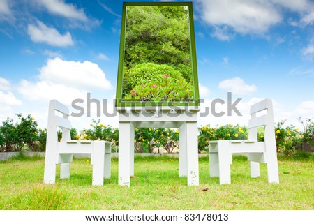 The white wooden chairs available. The tree. - stock photo