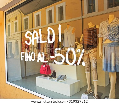 The white words FINAL SALE on Italian on the shop window - stock photo