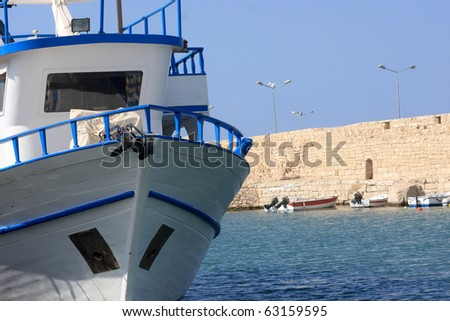 The white yacht is anchored in harbor of Retimo, crete