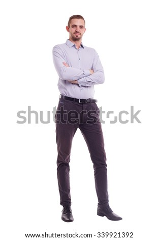 The whole figure of a man in shirt with crossed arms - stock photo