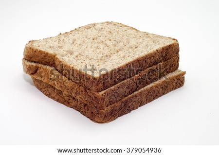The whole grain bread in focus over white background - stock photo