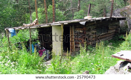 The wild house in mountains. - stock photo