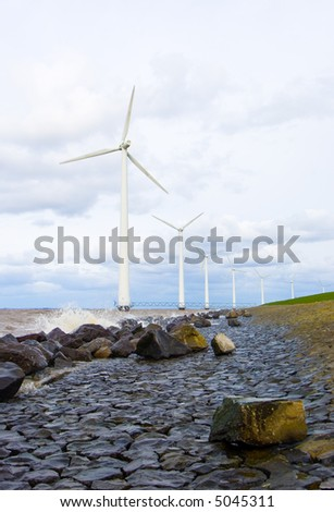 The wind turbines along a Dyke in the Netherlands