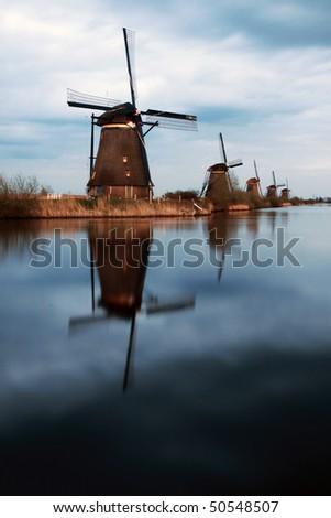 The windmills at kinderdijk rotterdam taken at sunset - stock photo