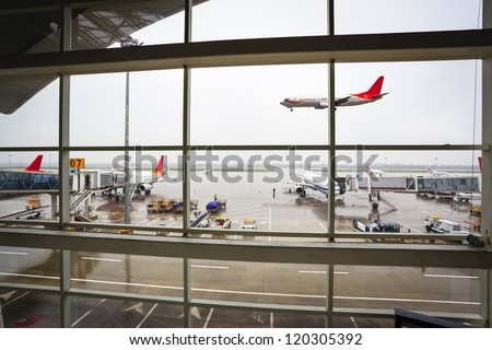the window of the airport terminal, an arriving flight - stock photo