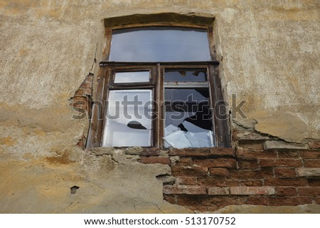 The window of the old abandoned house in provincial Russia. The house was built in the late 19th century.