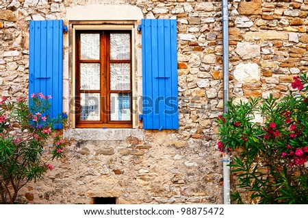 The Window on the Facade of French Stone House - stock photo