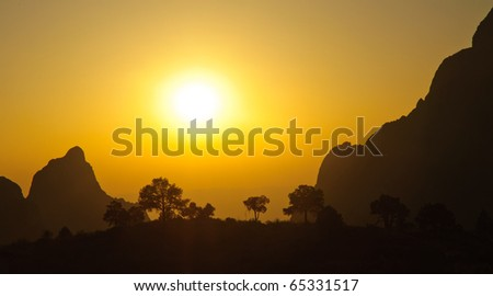 the Window overlook at sunset through a forest - stock photo