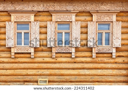 The windows on the facade of the wooden house. Old Russian country style - stock photo