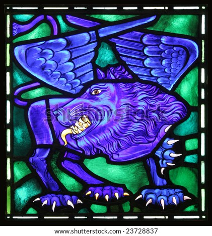 The winged lion is the evangelical symbol of St. Mark.  From an old stained glass window in an Anglican Church in Bermuda. - stock photo