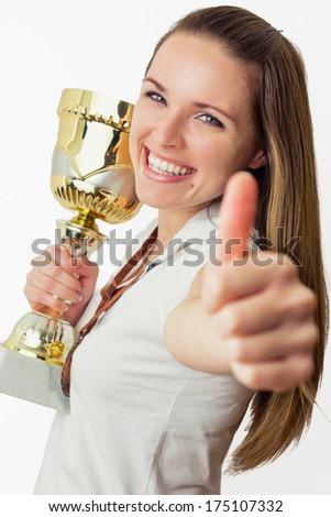 The winner / Beautiful young women win a trophy - stock photo