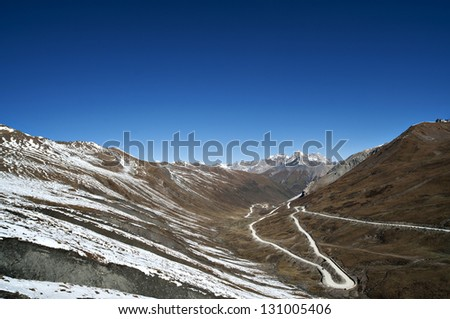 the winter highland landscape under the sunshine. - stock photo