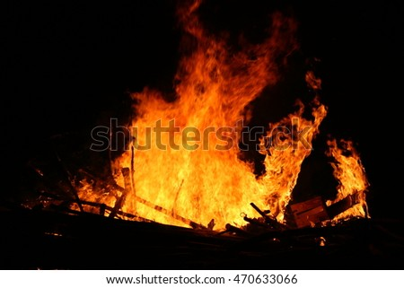 The witch who hides in the fire, unreal view of the feast of San Juan, traditional bonfire of San Juan,witch figure out the flames,traditional bonfire Galicia Spanish festivals and tourist attractions