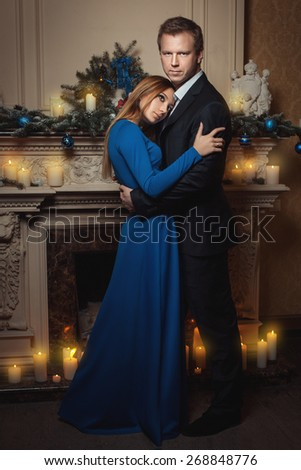 The woman bowed her head on the man's chest, her dreamy look. - stock photo