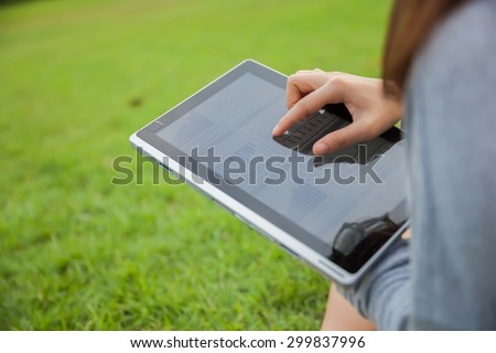 The woman checking reported profits in the garden.