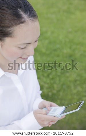 The woman checking the mail of mobile phone - stock photo