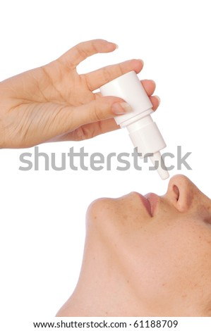 The woman drips drops for a nose for fast recover - stock photo