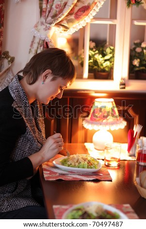 The woman has supper in the restaurant - stock photo