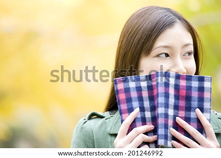 The woman hiding her face with a book