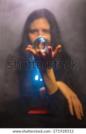 The woman holds a magic sphere - stock photo