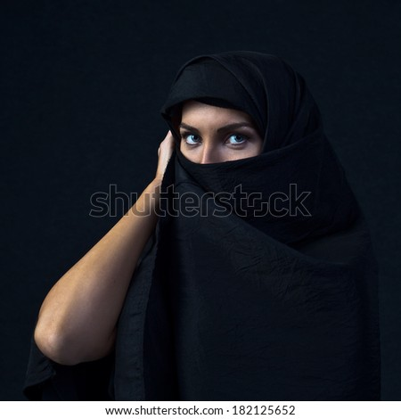 The  woman in a black coverlet - stock photo