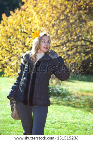 The woman in  autumn park