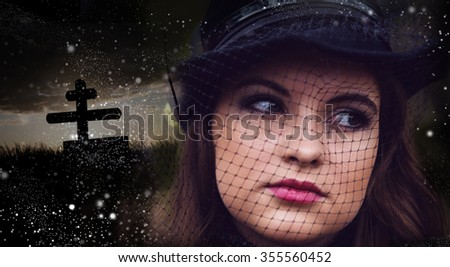 The woman in black, grieves, cries, to pray - stock photo