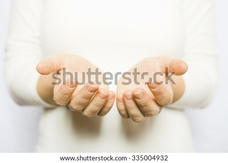 The woman in white holding open hands - stock photo