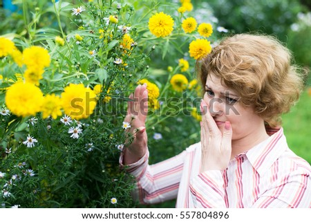 The woman is allergic to a flowers