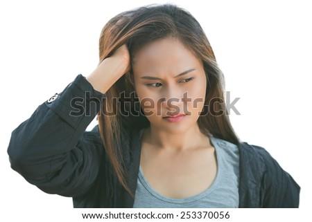 The woman is feeling job stress and headache - stock photo
