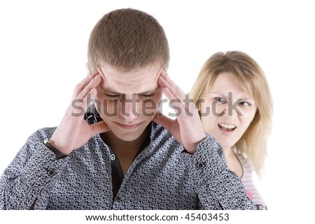 The woman shouts at the man. The man keeps hands for head - stock photo