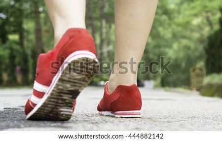 The woman walking,running,exercise in the park.