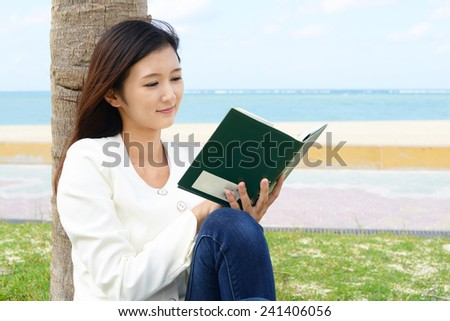 The woman who relaxes on the beachside - stock photo