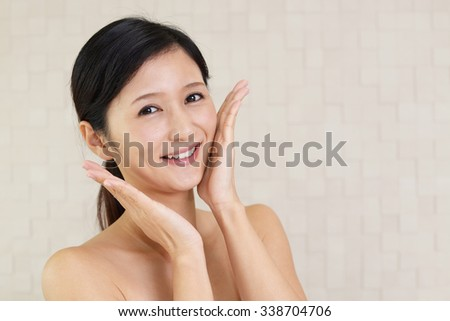 The woman who takes care of her face - stock photo