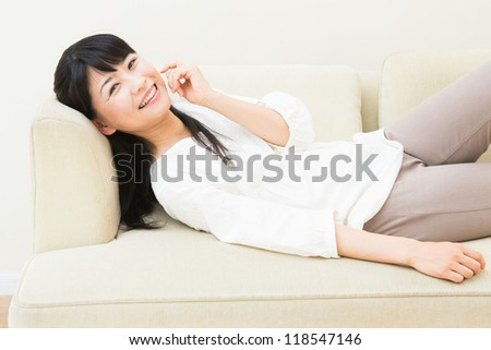 The woman who talks on the telephone in a sofa