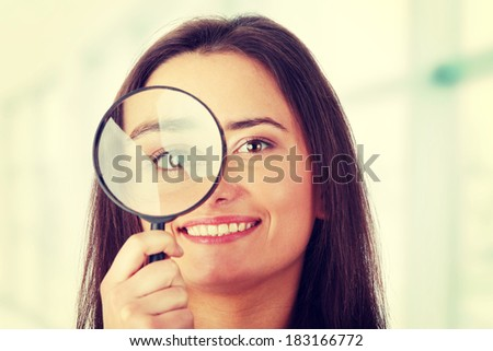 The woman with a magnifier in a hand