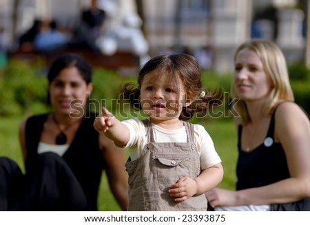 The women walk with a child. - stock photo