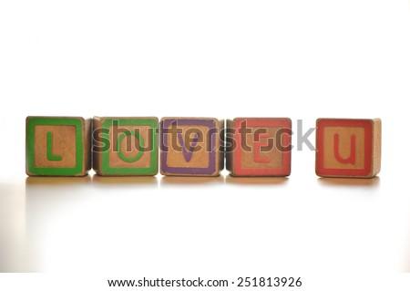 The wood alphabet love u - stock photo