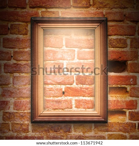 The wood frame on brown brick wall background - stock photo
